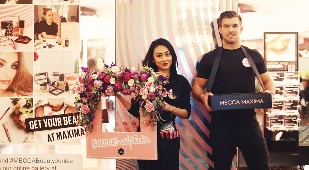 To help further push their already popular #MECCABeautyJunkie competition, NOW captured roaming photos of fans with the gorgeous floral frame after they've had their lippie done by a makeup artist.