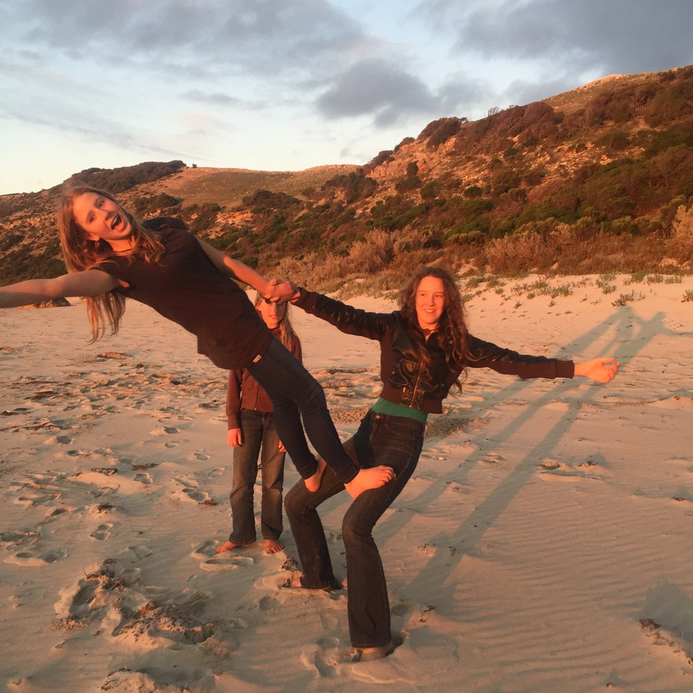 Girls-acro-on-beach.jpeg
