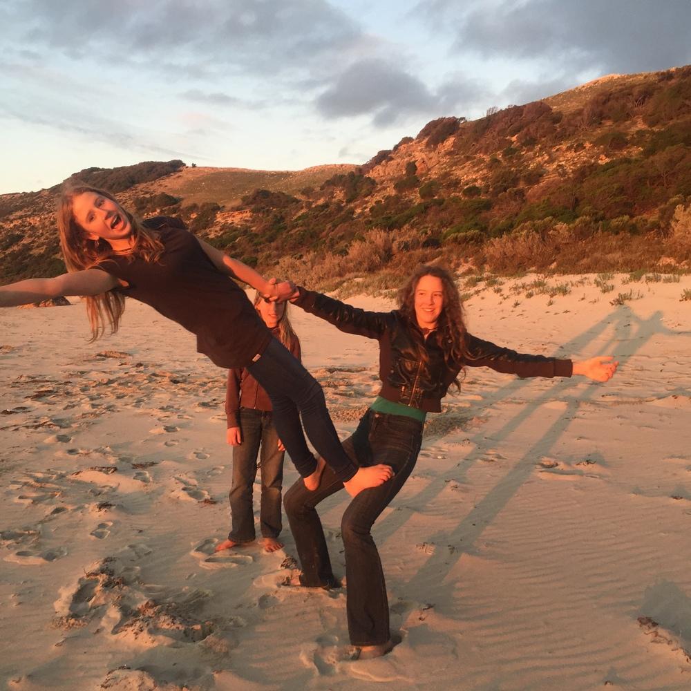 Girls-acro-on-beach.jpeg