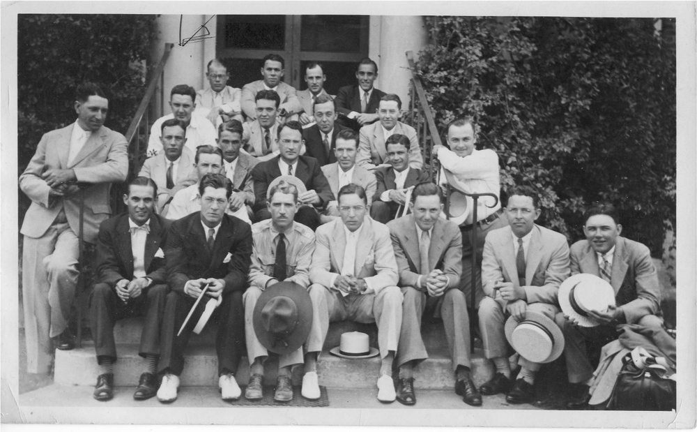 1935 Training Class Of SA John W. Core     Courtesy of his son, retired SA Bob Core, is a group photo of his father's training class in 1935. SA John W. Core is observed in second full row sitting with his hand on the shoulder of the agent in front of him. Bob tells us that his mother relayed a story to him that nearly one half of his father's training class was dismissed from the FBI the day before graduation. The reason is not fully known at this time. Instructor, SA Frank Baughman is observed in the bottom row, 3rd from the left. Others are currently not recognized.