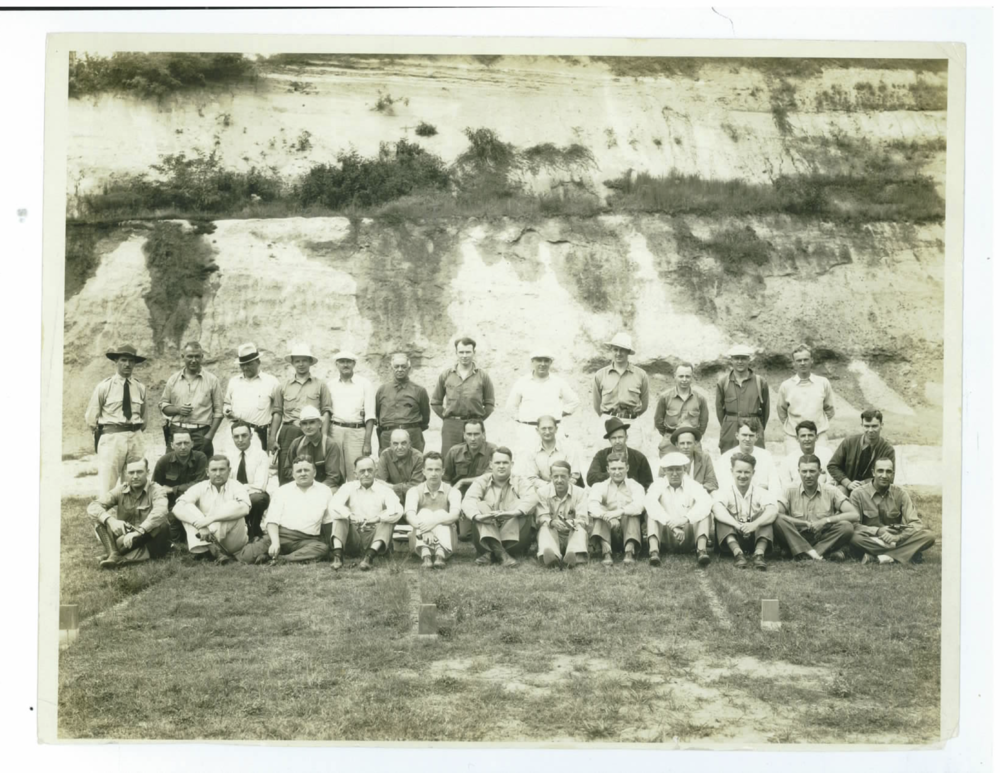 "1935 In Service Training Photo - SA Robert A. Guerin    SA Robert A. Guerin  (later an SAC) is shown (above) with other agents from around the country at a 1935 FBI In-Service Training. From the presence of legendary instructor, Frank Baughman, in this photo ( standing far left with ""Trooper"" hat), and the visual handguns,  no doubt they were attending firearms training as part of the In-Service curriculum.  SA Guerin is shown in the second row, last man on the far right.  Others shown cannot be immediately identified. ( Photo courtesy of his son, retired SA Rudy Guerin)    From his father's memoirs, ret. SA Guerin also  shared this account his father wrote during retirement.  It reflects a 1937 raid he participated in at Atlantic City, NJ involving an organized prostitution ring and violations of the White Slave Traffic Act, commonly known as the Mann Act. The Bureau had been involved in these type investigations since its early founding and involved transporting women over state lines for illicit purposes. The social impact - real or imagined - of these organized prostitution rings by organized crime and others can be further researched by readers if interested."