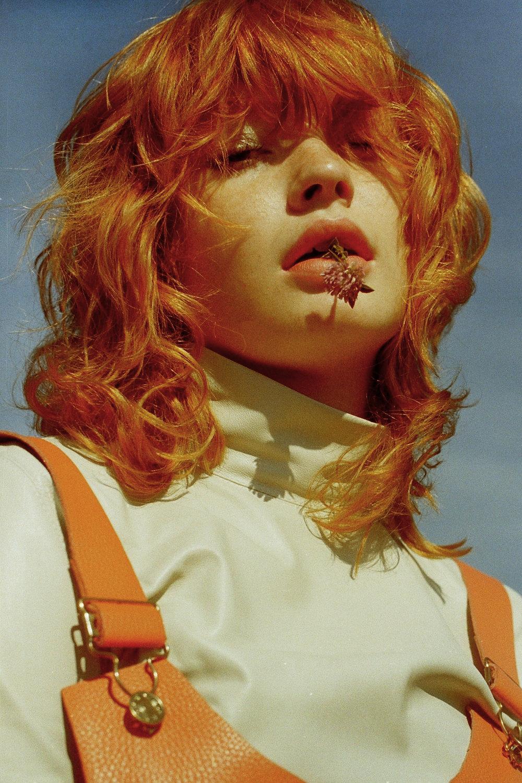 top    TAMUNA INGOROKVA   , orange leather dress    LINDY FOX   , shoes    PALOMA BARCELO   , ear cuff + ring    SARINA SURIANO