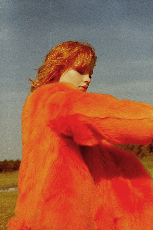 orange fur jacket   PALOMA BARCELO   , maroon dress  SCHAI ,shoes     NICHOLAS K    ear cuffs  DAISY DION
