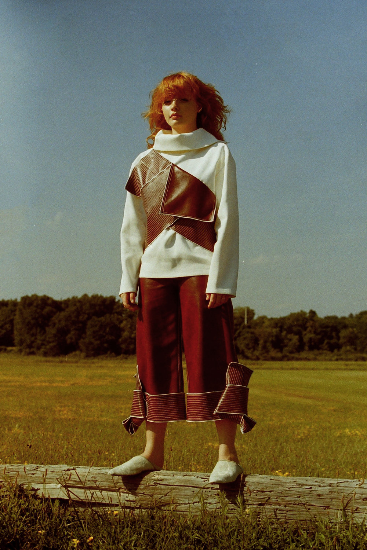 top + trousers  CLAUDIA LI , white fur  shoes     NICHOLAS K , ring     SARINA SURIANO