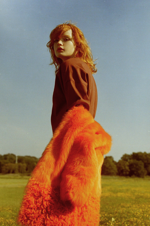 orange fur jacket   PALOMA BARCELO   , maroon dress  SCHAI ,shoes     NICHOLAS K ,  ear cuffs  DAISY DION