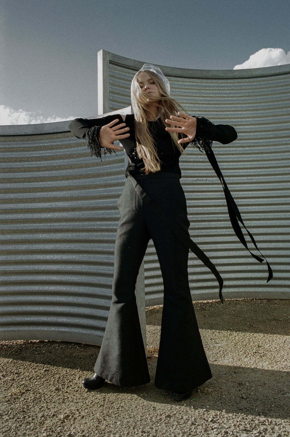 top + choker  ALYX STUDIO , raincoat STYLIST'S OWN, trousers  ELLERY,  boots  STOLEN GIRLFRIENDS CLUB