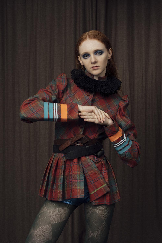 collar COSTUME STUDIO, jacket BAREIA AHMAD, shorts STYLIST'S OWN .
