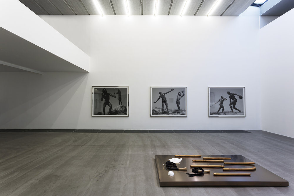 Two videos, three photographs, several related masterpieces, and American art, 2013. Installation view, Galerie Urs Meile, Beijing, China, 2013.