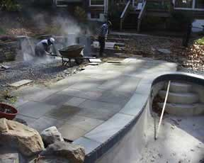 New stone deck added to poolside.