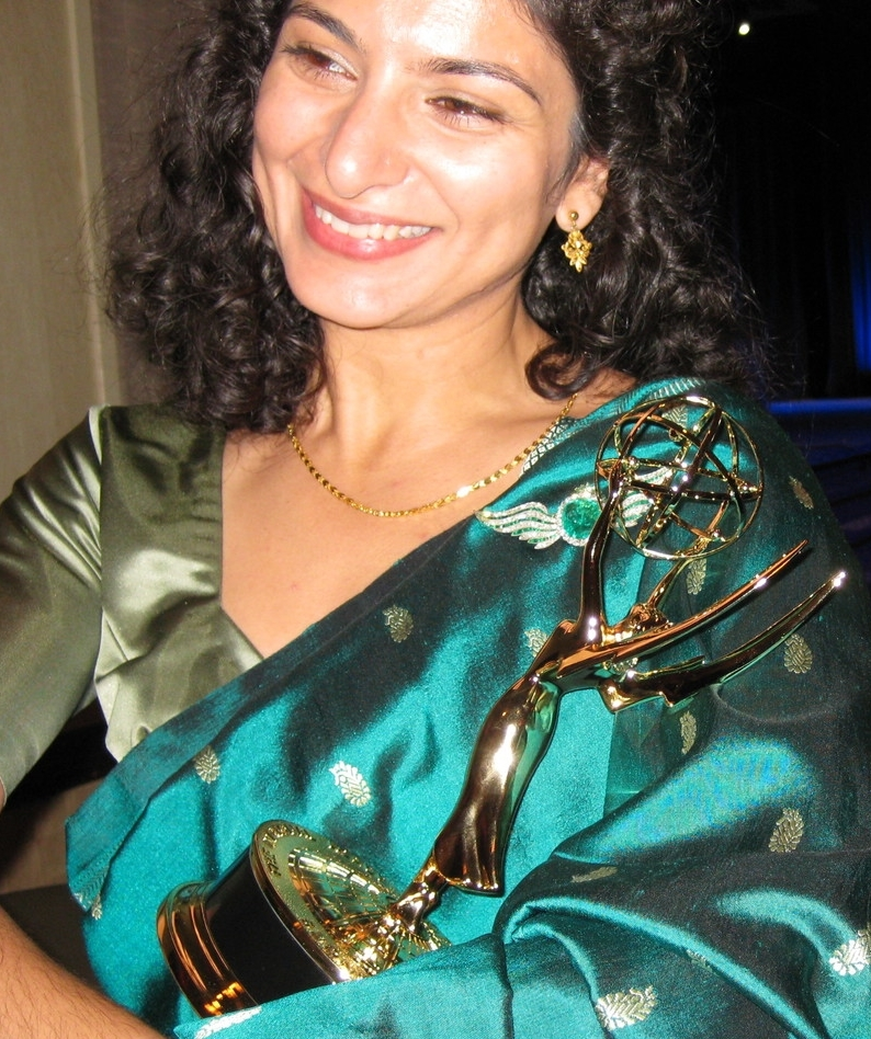 Kayhan at the 2010 New York Emmy Awards with her Emmy as screenwriter for We Are New York.