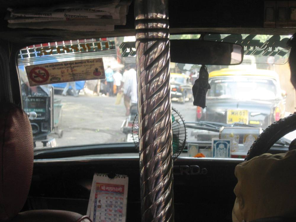 What's with the pole in this cab? I have a hundred questions.