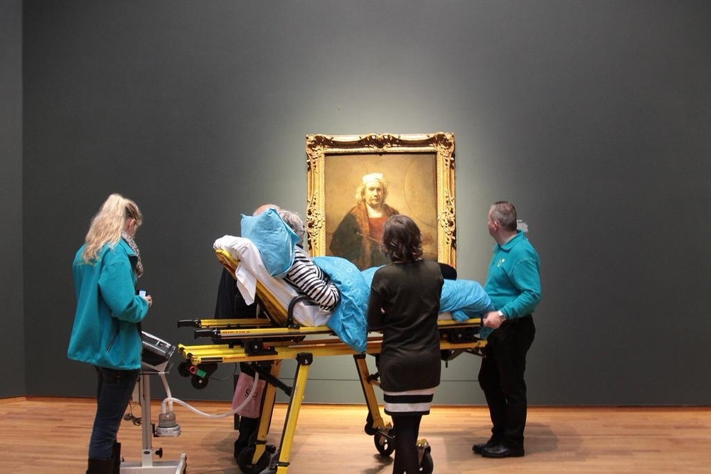 A terminal patient enjoys  Rembrandt  paintings at the Rijskmuseum, Amsterdam, one final time. Photo credit: unknown.