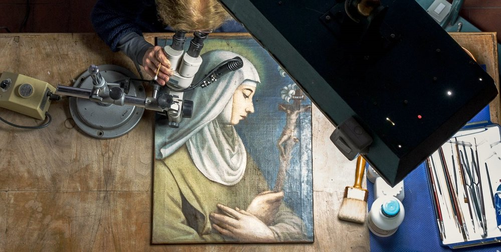 Restorer Rossella Lari works to restore a Saint Catherine by Florence's first artist, Plautilla Nelli.