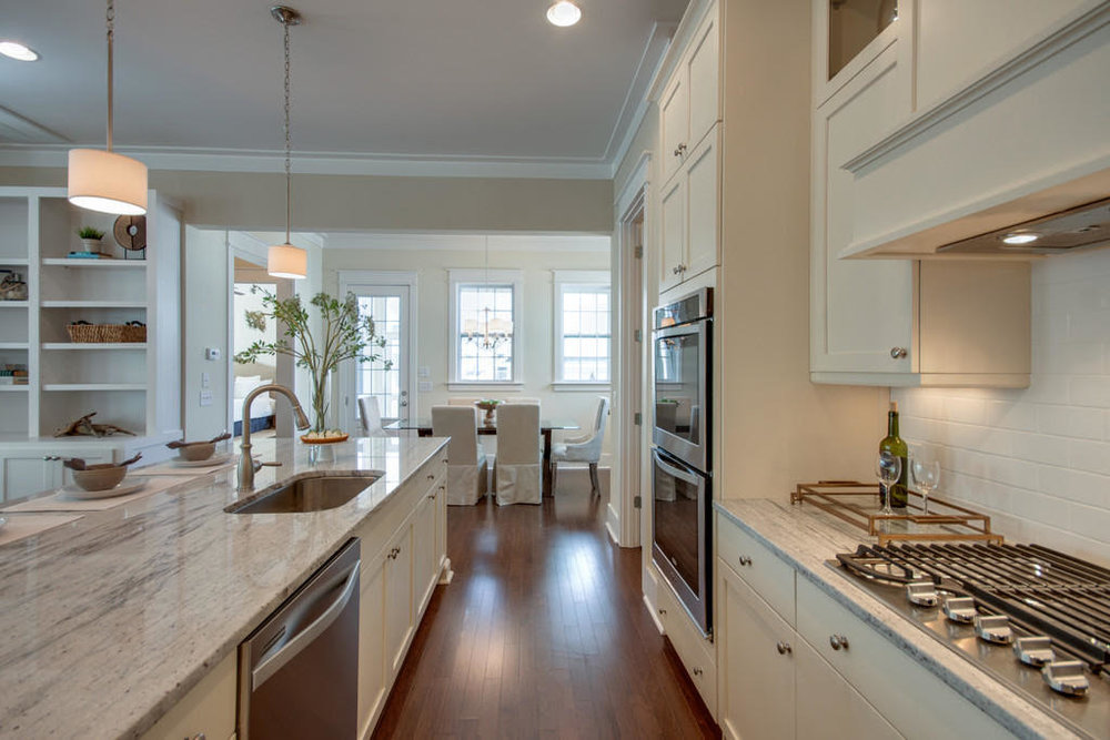 Gourmet kitchen: granite counters, stainless steel appliances & kitchen island