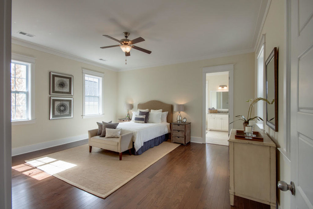 Spacious master suite with dual vanities, tiled shower & freestanding oval tub