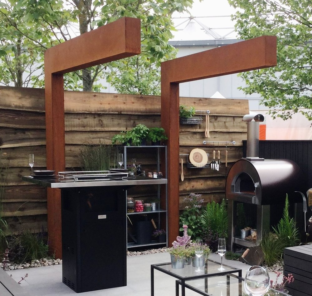 Corten Steel Cantilevered Pergola Providing Privacy For Outdoor Kitchen.  Designers: Michael McGarr And Rob