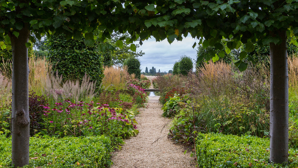 Movement from repeated upright grasses immerses you within the space and encourages you to linger. Designer: Tom-Stuart Smith at Broughton Grange. Image: Chris Denning/Verve Garden Design.