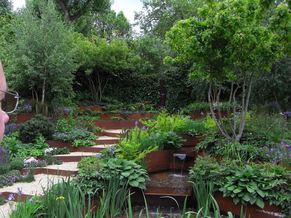 Corten steel raised beds. Designer: Patrick Collins. Image: Lorraine Young/Verve Garden Design.