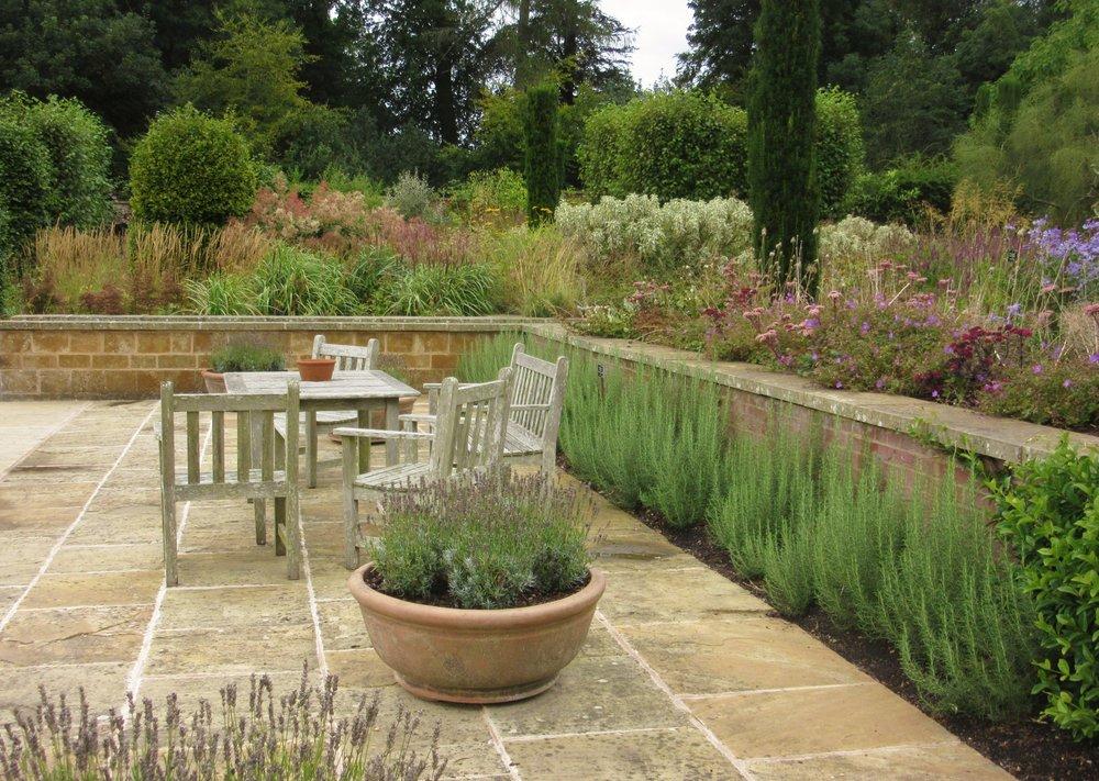 Brick and stone raised beds at Broughton Grange. Designer: Tom Stuart-Smith. Image   Chris Denning/Verve Garden Design.