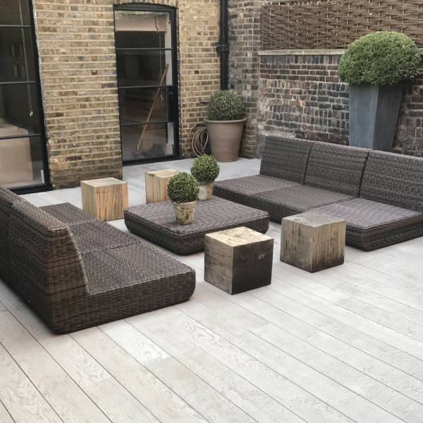 Millboard composite decking in contemporary patio.