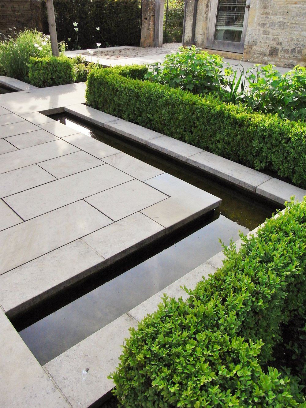 Beautifully-laid limestone patio designed by Jinny Blom. Image: Lorraine Young/ Verve Garden Design.