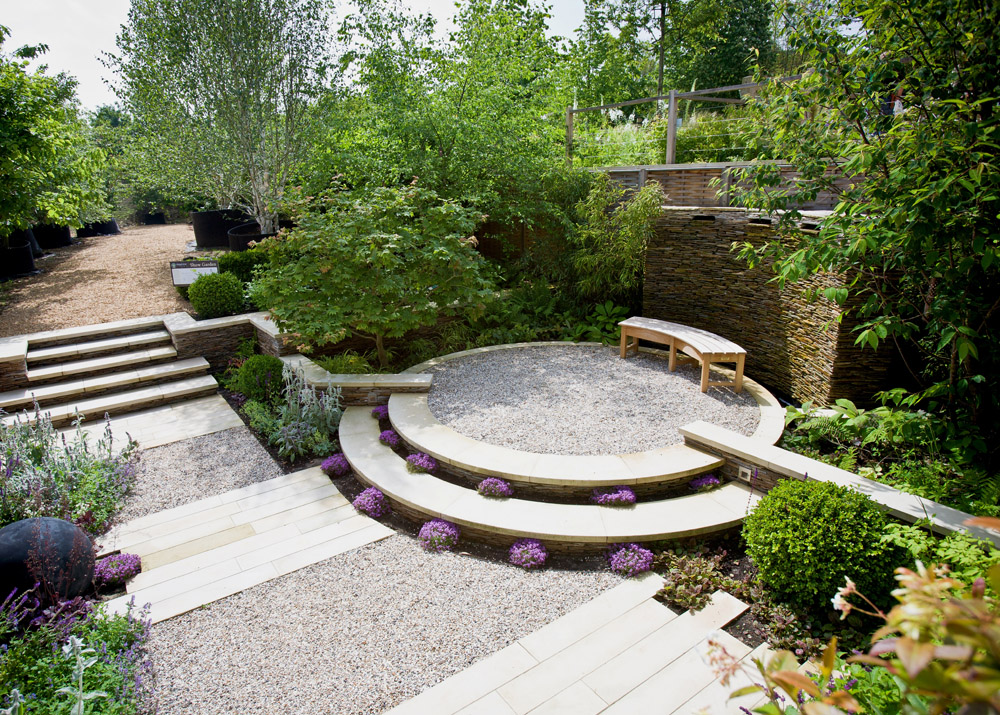 Circular Patio of Buff Sandstone and Flint Gravel Circular Patio from CED Natural Stone. Designer Helen Thomas