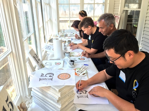 Painting planter box signs during the Google Team-Building Event