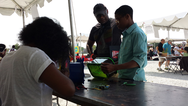 Englewood Codes students Kyla Brown and Marquis Sewell present their lamps at the  Southside Maker Faire in August.