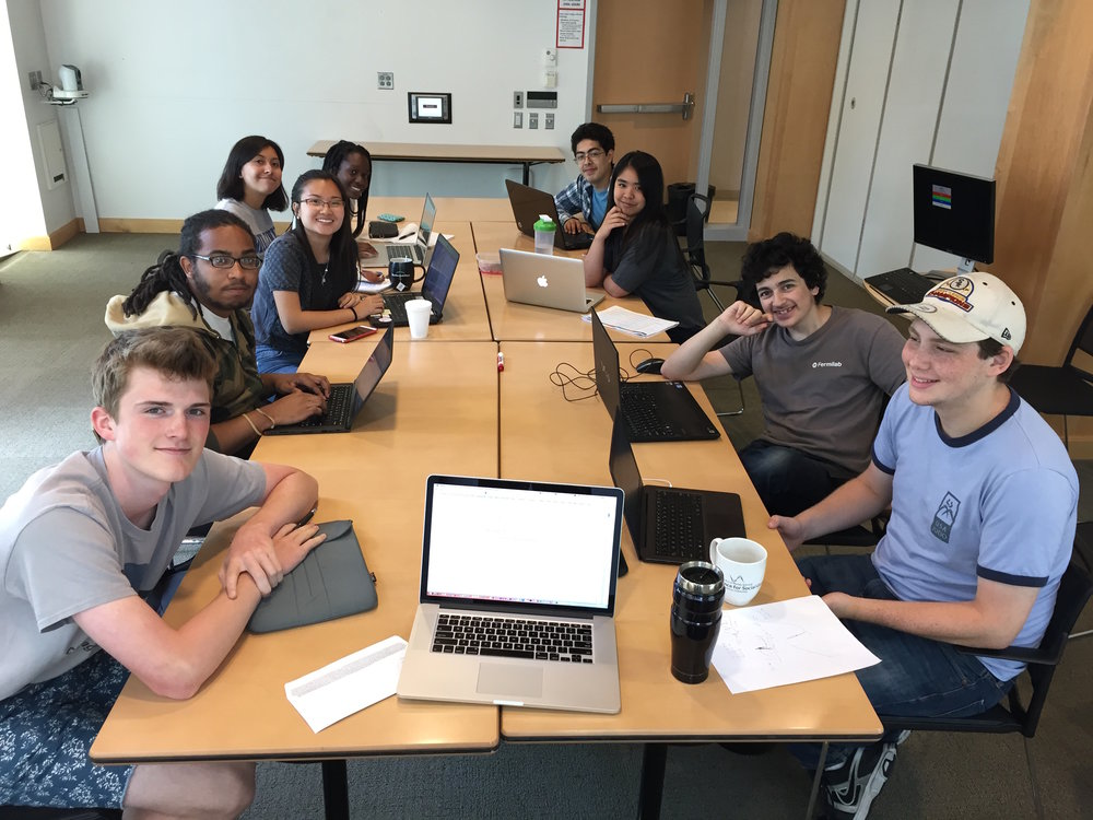 2015 Summer Students preparing for a group meeting