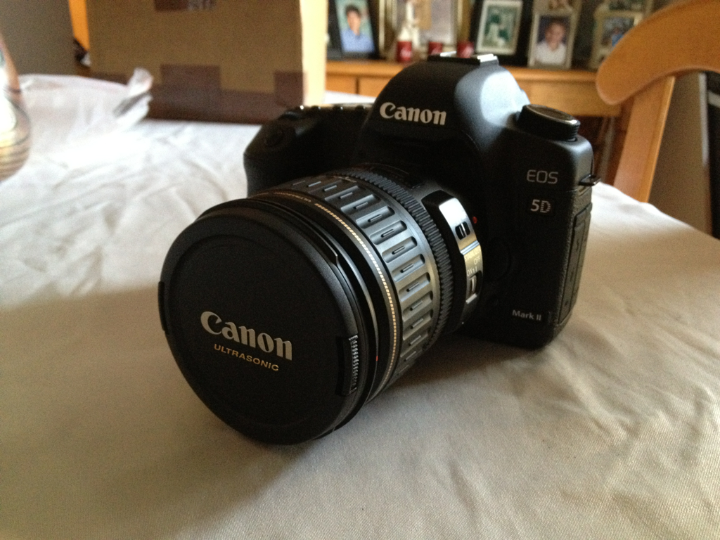 So, my Canon 5D Mark II came today! So excited! The battery was fully dead when I got it, so I'll have to use it late tonight :( going to Best Buy to see if they have anything for it!