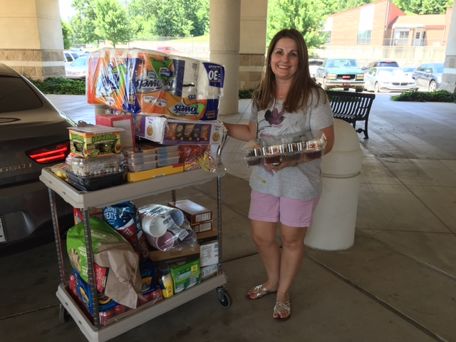 Rachel Fields, Red Shoe Shindig 2016 committee member, with donations she brought for Share-A-Meal and Wish List to Fort Smith last week.