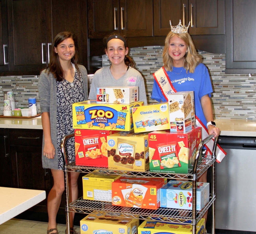 Family Room volunteers Annie Bachmayer and Avery Duncan of the Crown Club were organizing the kitchen when Mariel stopped by, so they also put all of the donations away! We love our volunteers. :)