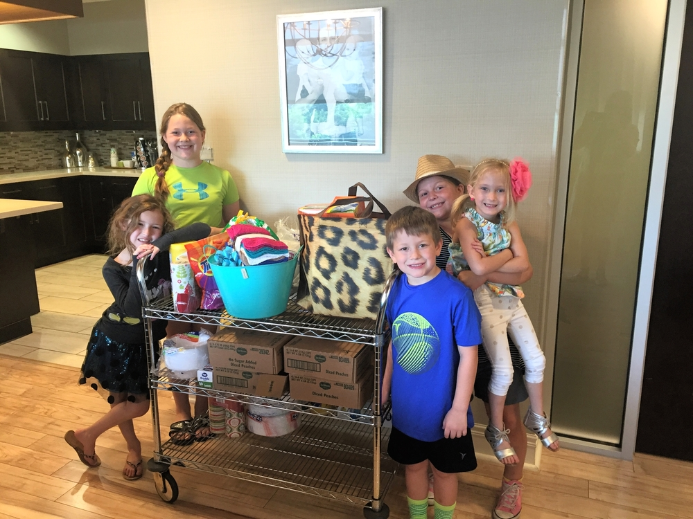 Tiny Hummingbirds, founded by Holly Walker, recently brought by a cart full of donations to the NWA Family Room! The delivery was made by Emry and Alli Walker, Laney, Cade, and Sadie Stein, and Riley Gibson (not pictured).