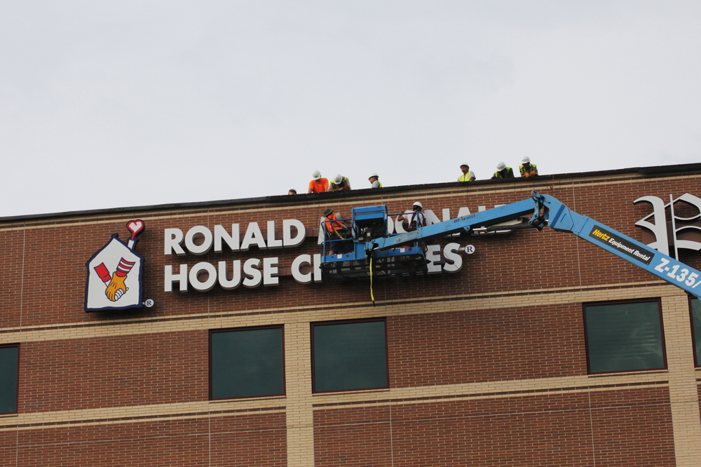 Signarama NWA installing our sign on the new Washington Regional Medical Center tower.