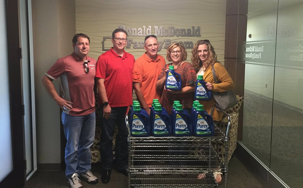 Teresa Richardson's team from Henkel brought a generous donation of laundry detergent to the Family Room in Rogers this week!