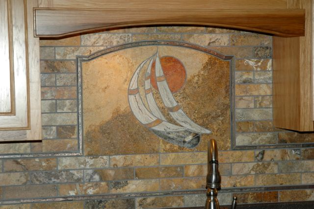 This nautical themed mural was entirely fabricated in our studio from natural stone.  The design reflects the client's fondess for our local Grand Lake in Celina, Ohio.