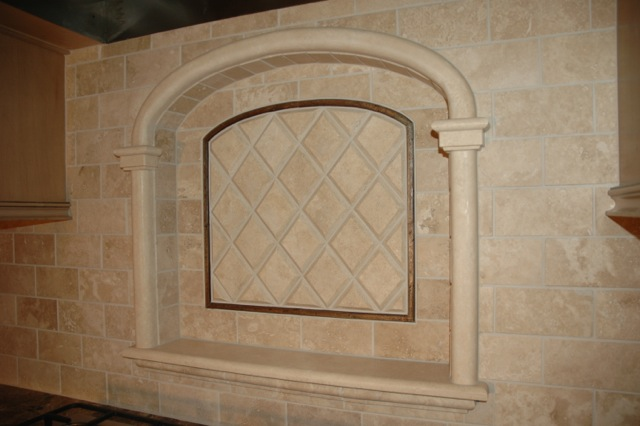 This is a custom-fabricated focal point; all of the components were hand-crafted out of Durango stone in our studio.