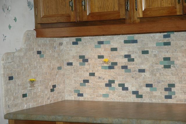 a combination of custom blended glass and natural stone tile