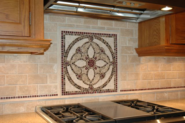 We designed and built a custom mosaic per our customer's request and surrounded it with Durango stone in a 3 X 6 rectangle.  We will soon build a stained glass window for the kitchen which will repeat the mosaic design.