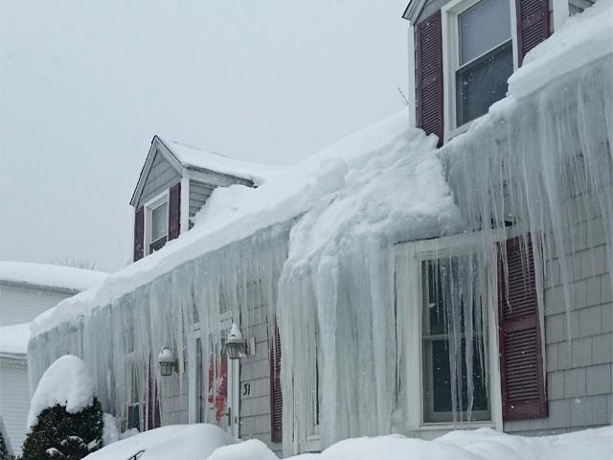 An example of serious ice dams. These will create expensive damage to your home.