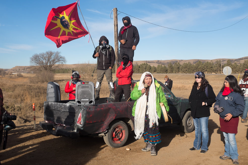 Loud speaker at the November 15 action blocking the county road to the man camp west of Mandan, North Dakota.