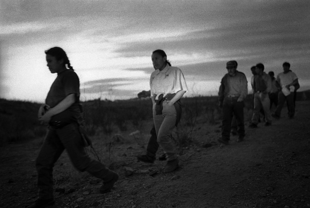 Immigrants crossing the border near Agua Prieta, Sonora, 2005. Photo by  Julian Cardona .