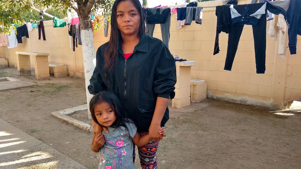 Estela Magdalena Simon Esteban and her three-year old daughter, Zaida, at Casa del Migrante in Juarez, Chihuahua. After her husband crossed to the US without documents, a man made constant attempts of sexual assault against Estela and she decided to leave her town, Playa Grande, Guatemala. Now she seeks to apply for political asylum to reunite with her husband in Salisbury, Maryland. Photo by  Julian Cardona .