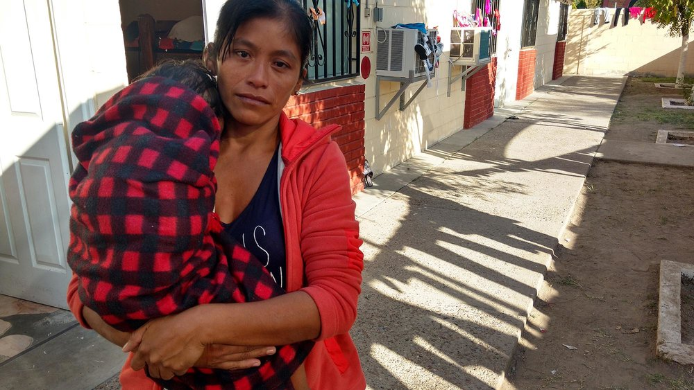 Juana Machenaquenich, 34, at Casa del Migrante. She was forced to leave Guatemala because several men were constantly trying to rape her 16-year-old daughter, Andrea Patricia. With Andrea and her two-year-old daughter Zuly Raquel (pictured) she will try to cross the border to reunite with her husband who lives undocumented near Washington D.C. Photo by  Julian Cardona.