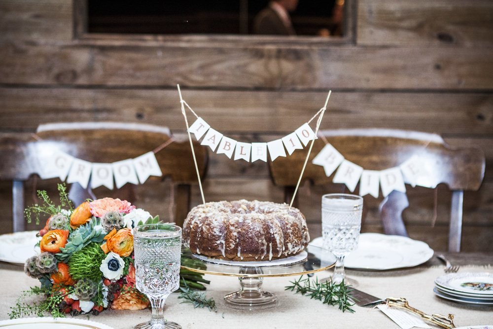 Meg and Brandon's sweetheart table at their fall  Vinewood Plantation  wedding. Photo by  Libby Photo .