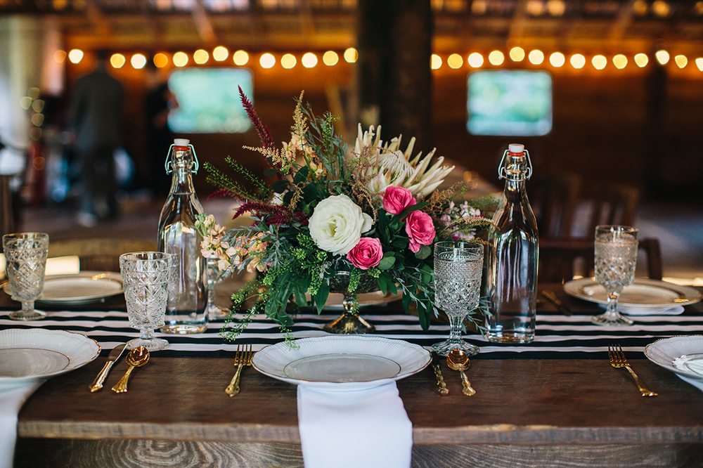 Nicholette and Seth's Kate Spade inspired modern rustic wedding with our vintage clear stemware, gold collection china and gold flatware at  Vinewood Plantation   coordinated by   Signature Weddings and Events  florals by  Southern Stems  photo by  Caroline Fontenot Photography