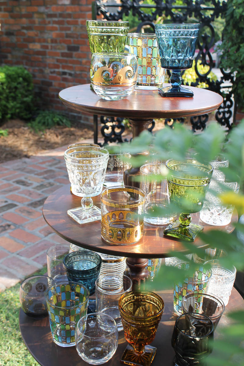 The sun setting in the  Cannonball House  backyard was the perfect lighting for  Southern Vintage  unique  lowballs  and  wine glasses  to sparkle on our  three tier table, William.