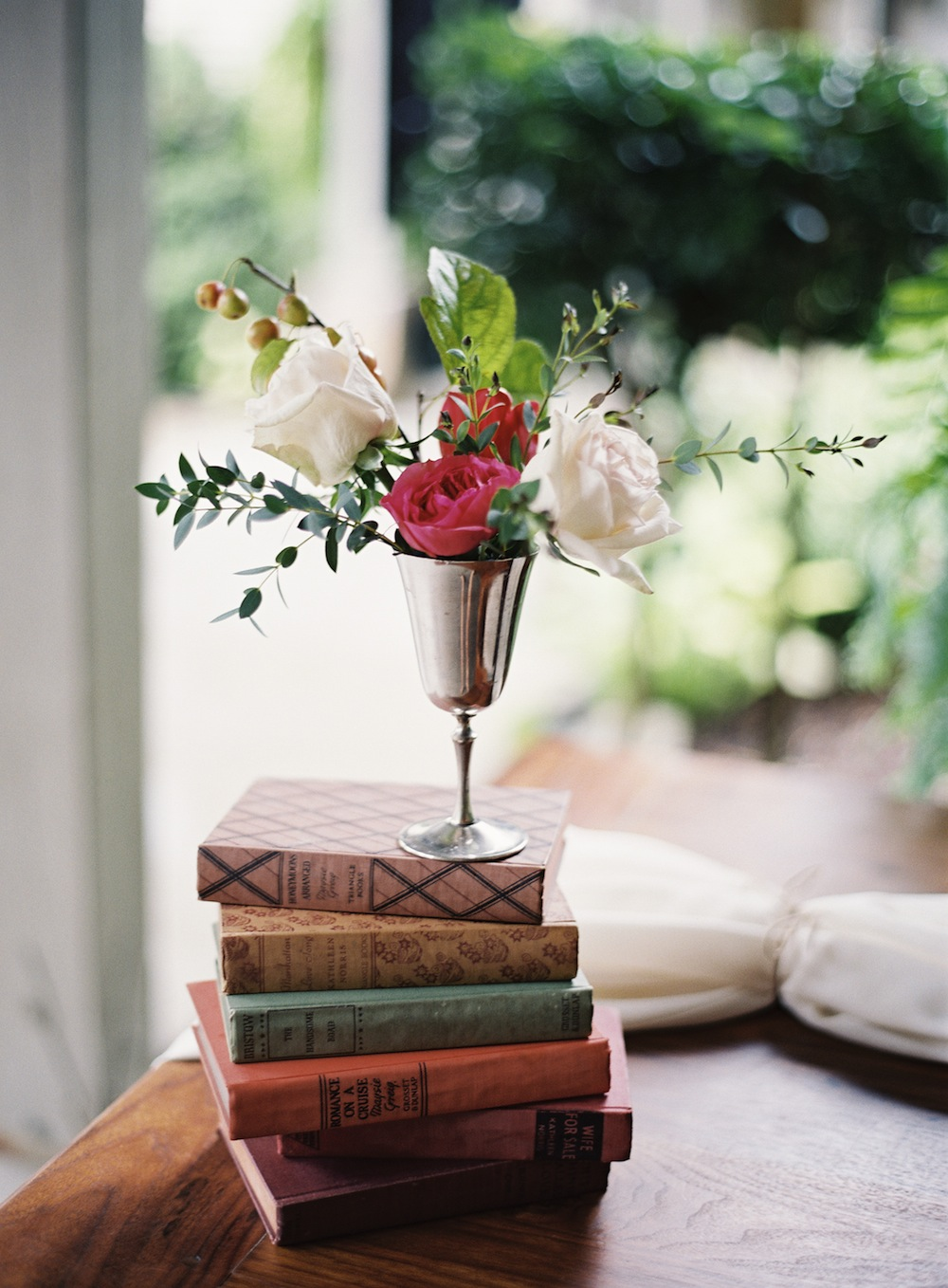 We brought silver vessels for flowers and vintage books for detail shots.