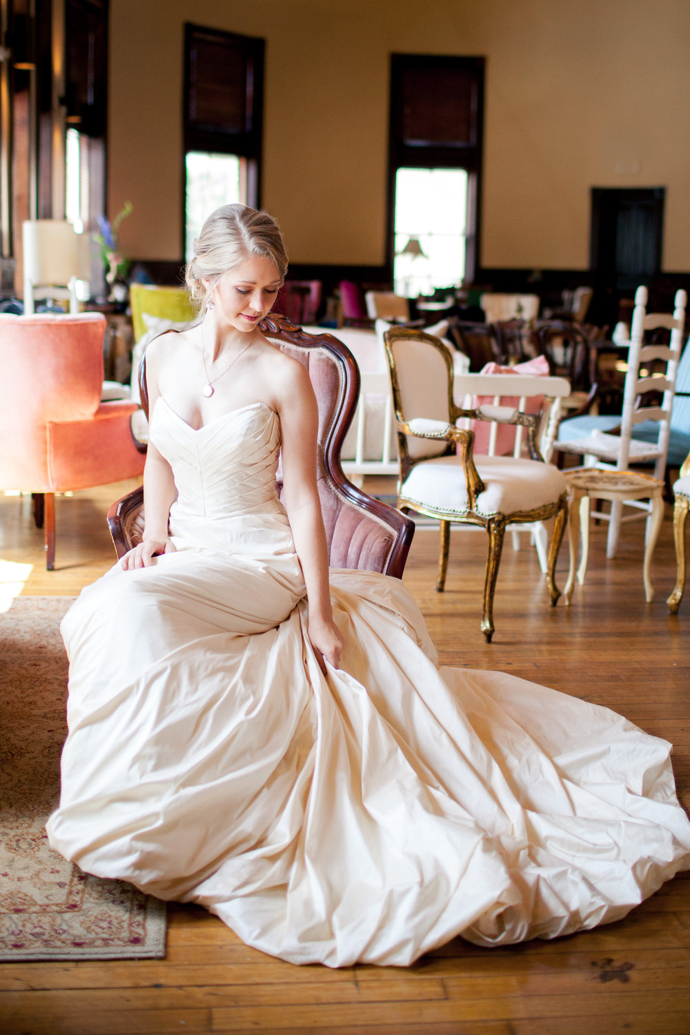 Elena looks stunning in her wedding gown from Fabulous Frocks of Atlanta sitting in her favorite chair in our collection, Elizabeth.