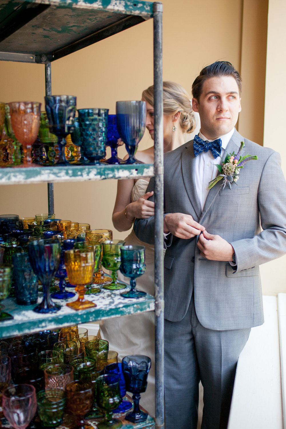 Zach looking very dapper in his gray suit and bow tie from  Madison Tie s.
